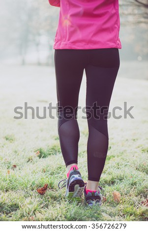 Runner woman legs on winter track, healthy lifestyle concept - stock photo