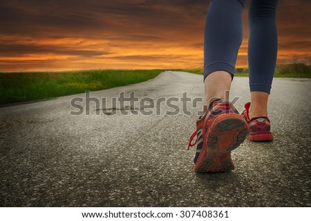 Runner woman on the road in sunset