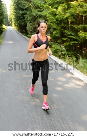 Runner - woman running outdoors training for marathon run motion blur - stock photo