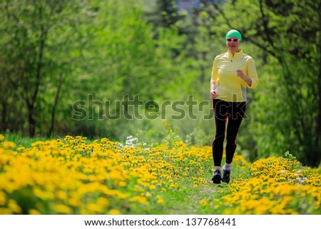 Runner - woman running outdoors, training, healthy lifestyle concept - stock photo