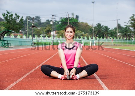 Runner woman smiling - stock photo