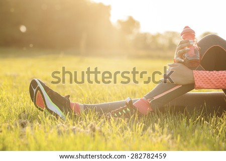 Runner woman warm up - stock photo