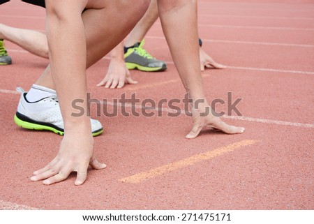 Runners at the start of the running track - stock photo