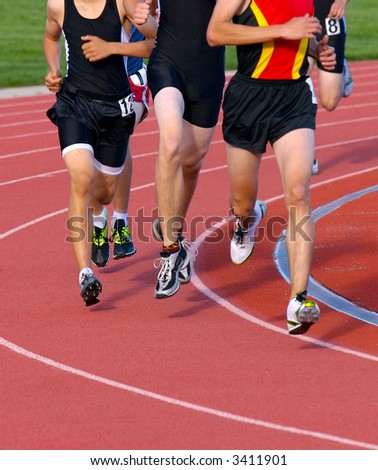 Runners during a long-distance track event - stock photo