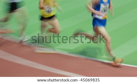 runners in track and field - stock photo
