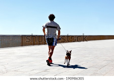 Runners on the beach. Seascape. - stock photo