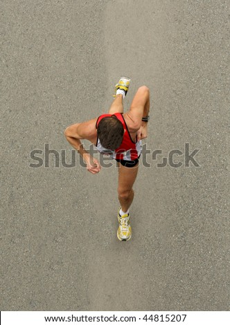 Runners on the road from zenith view - stock photo