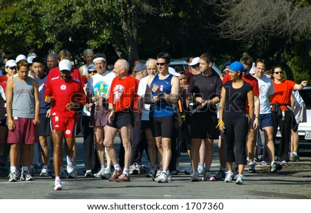 Runners preparing for a road race - stock photo