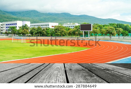 runners racetrack   surrounded by mountain in university - stock photo