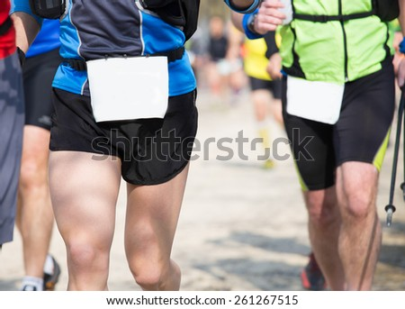 runners run in the outdoor race on the road - stock photo