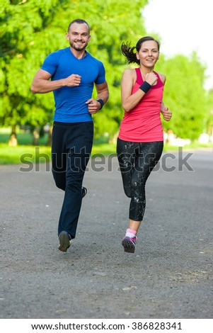 Runners training outdoors working out. City running couple jogging outside.  - stock photo