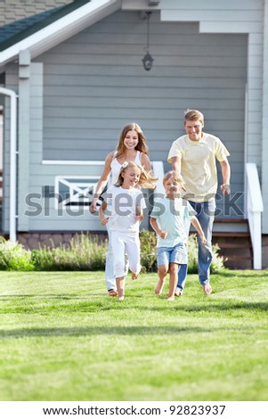 Running a family on the lawn - stock photo