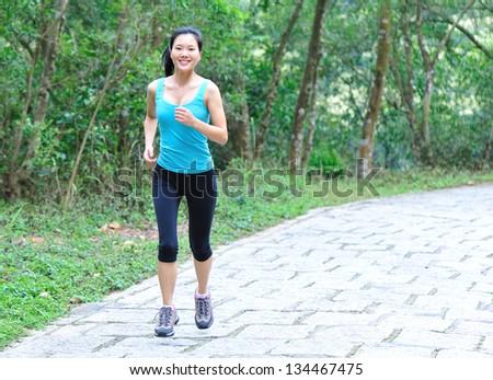 running asian woman outdoor - stock photo