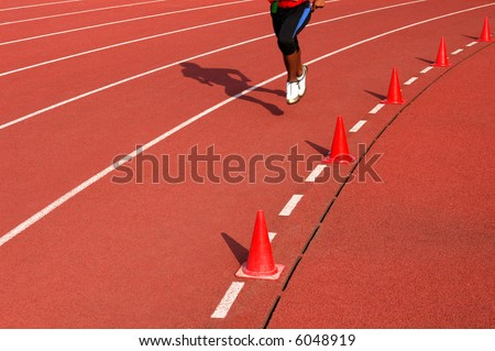 Running athlete at the stadium - stock photo
