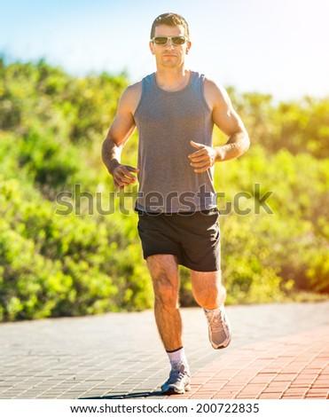 Running athlete. Male runner outdoors - stock photo