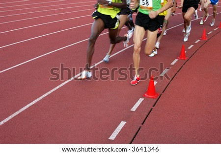 Running athletes at the stadium - stock photo