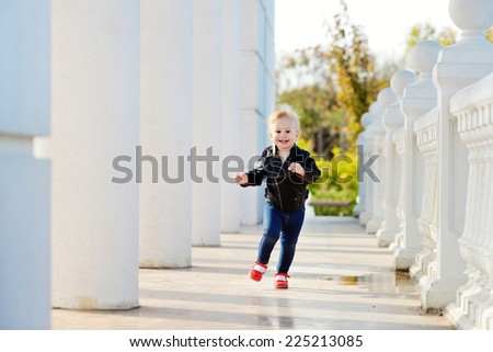 running baby girl in motion - stock photo