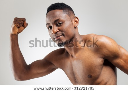 Running blac man over the light background with persistent look
