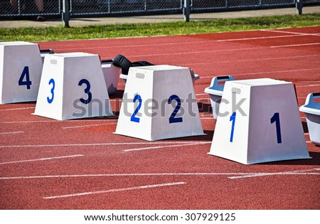 Running blocks on the running track - stock photo