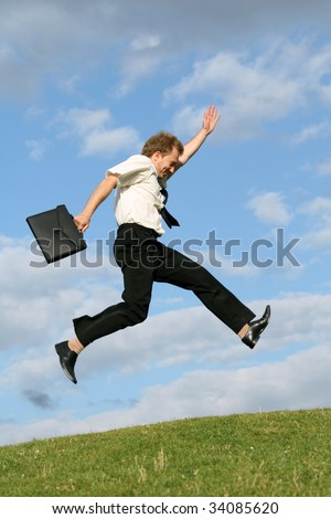 running businessman in the air with bag - stock photo