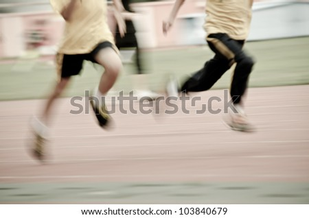 running child on sport track, blurred motion abstract background - stock photo