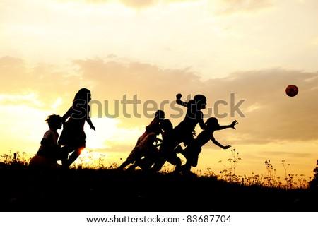 Running children, ball sport, group relaxing - stock photo