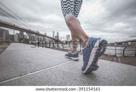 Running close up. Woman training in New york city for the marathon. close up on her shoe - stock photo