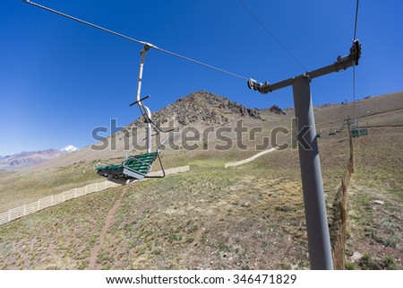 Running empty ski lifts at Penitentes in the Aconcagua National Park during the summer with Andean mountain in the background, Argentina