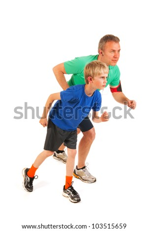 Running father and sun standing in studio - stock photo
