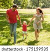 running field family on green sunny day - stock photo