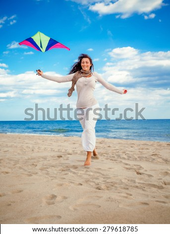 running for more wind flying high - stock photo