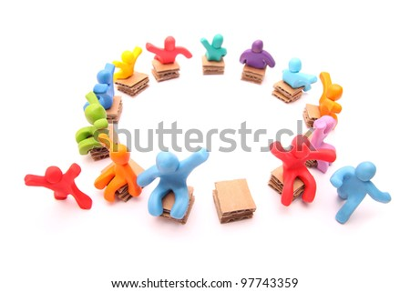 running for the last free spot - colorful group of plasticine people playing musical chairs - isolated on white - stock photo