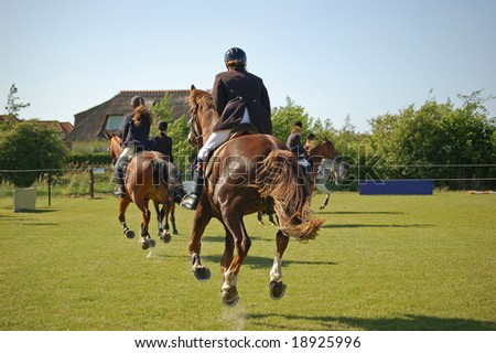 running galloping horses during a competition - stock photo