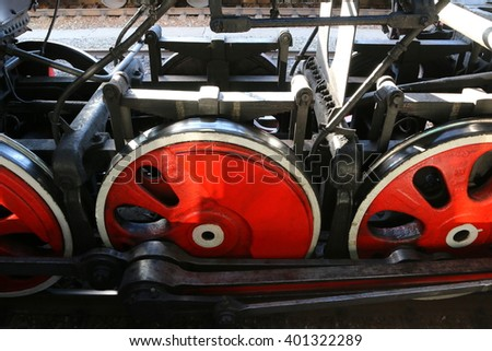 Running gear of a very old steam locomotive - stock photo