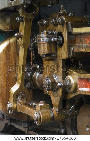 Running gear of old steam engine stained by oil used for lubrication.