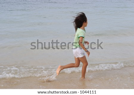 running girl on tropical beach-Hawaii