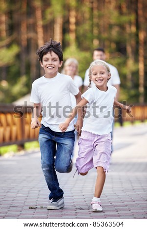 Running happy kids outdoors - stock photo