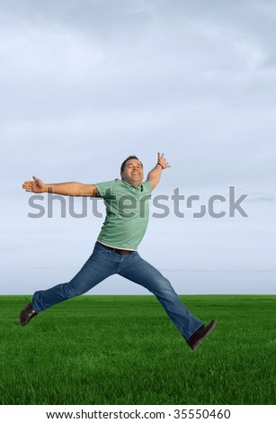 Running  joy young happy man in the meadow - stock photo