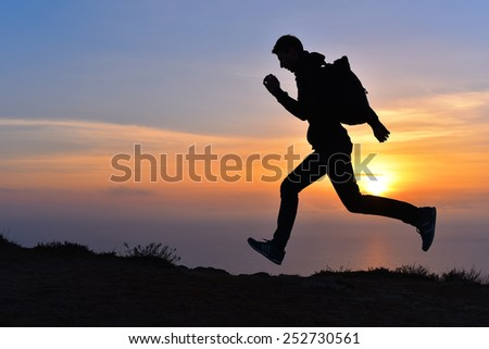 Running jumping man above sunset and mountain. Sport sky sun nature