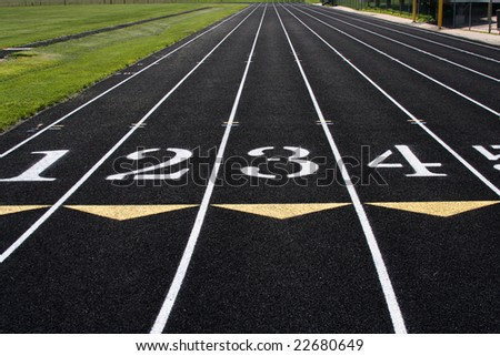 Running lanes on a track and field track. - stock photo