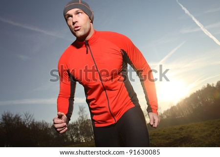 Running - male runner - stock photo