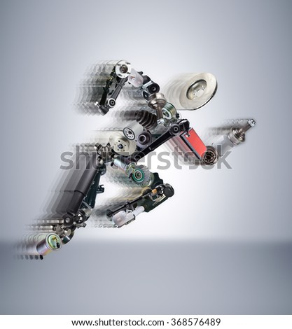 Running man assembled from spare parts. To use in the advertising of spare parts for passenger and sports cars. - stock photo
