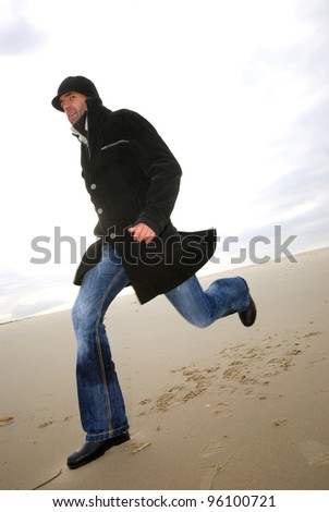 running man at the beach