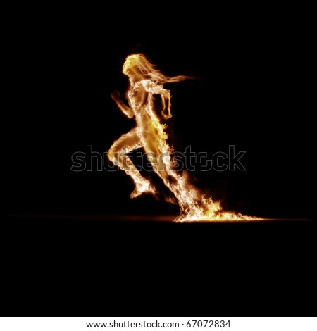Running Man, enveloped in flames on a black background - stock photo