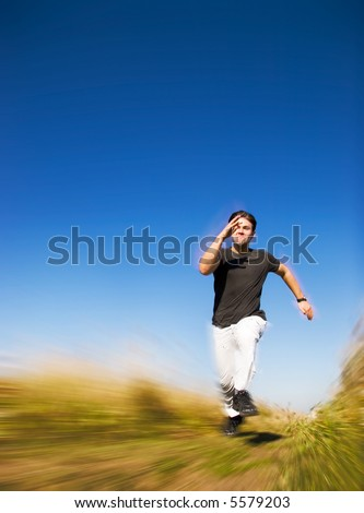 Running man. Photo with motion blur to raise speed. - stock photo