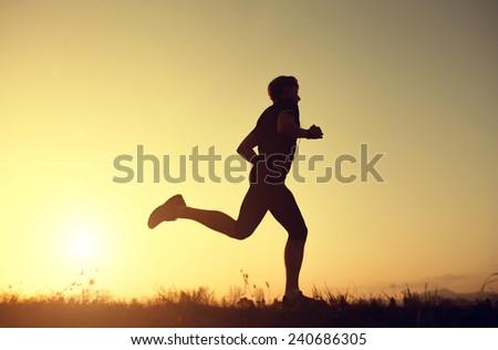 Running man silhouette  - stock photo