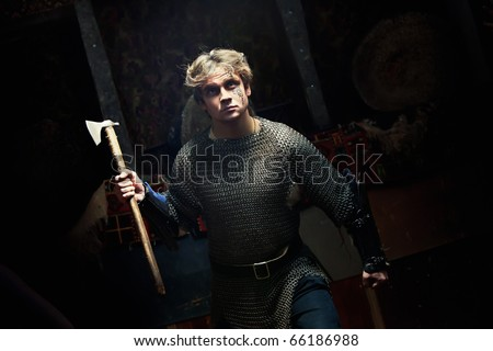 Running medieval warrior in the chain armour with the axe