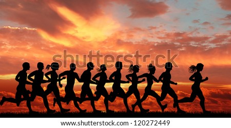 running motion on sunset background. - stock photo