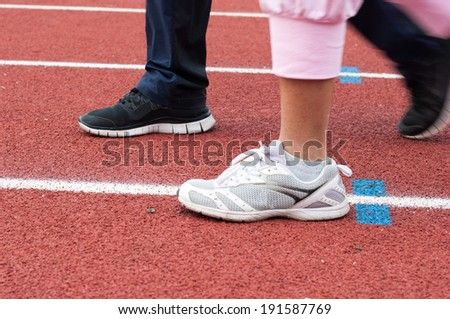 Running on the red running track - stock photo