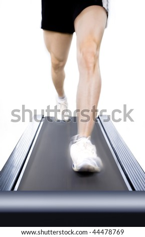 Running on treadmill - stock photo